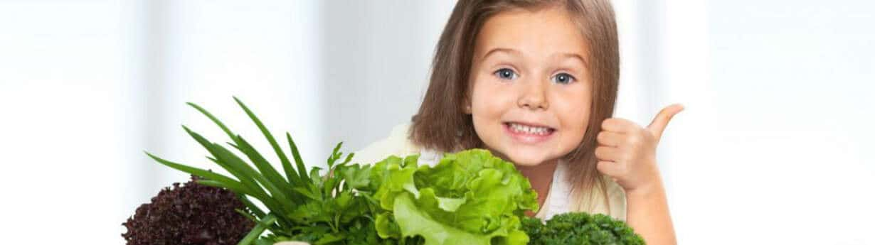 little girl with salad