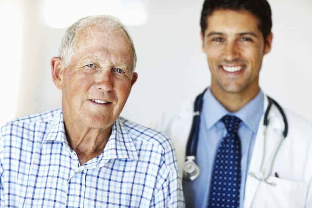 Older man with doctor