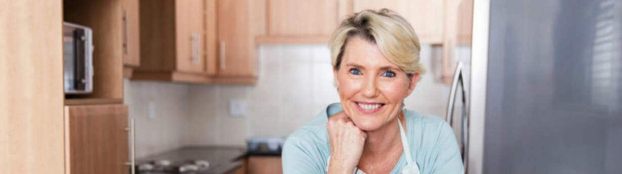 middle aged lady in kitchen