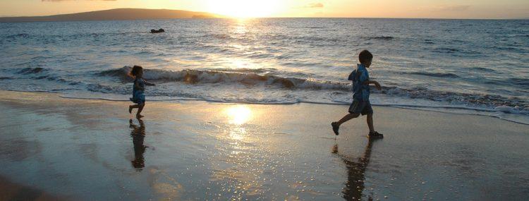 Healthy children running on beach
