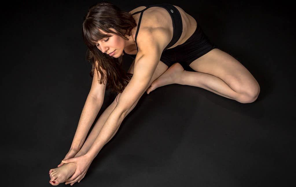 woman stretching - strong bones - calcium